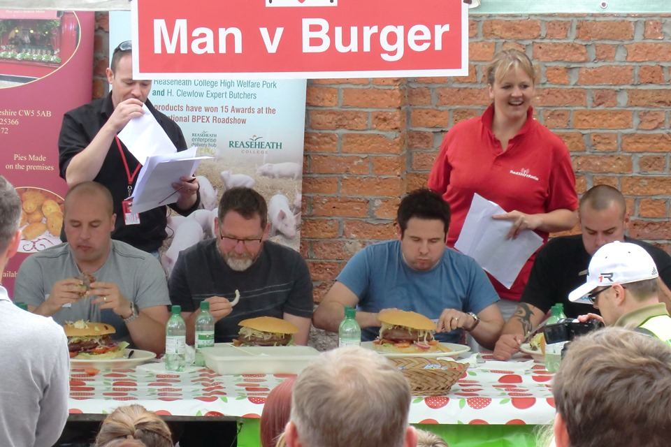 Picture of people eating ridiculously large burgers