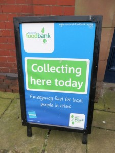 Foodbank sign inviting donations
