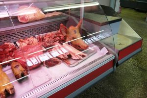 A picture of a pig's head and other parts for sale